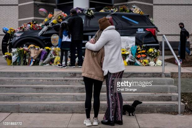 Sarah O'Keefe and Maura Kieft pay their respects to Officer Eric Talley, who was killed after a gunman opened fire at a King Sooper's grocery store...
