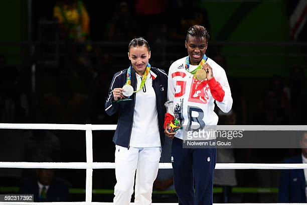 Sarah Ourahmoune of France and Nicola Adams of Great Britain during a Women's Fly final bout on Day 15 of the 2016 Rio Olympic Games at Riocentro...