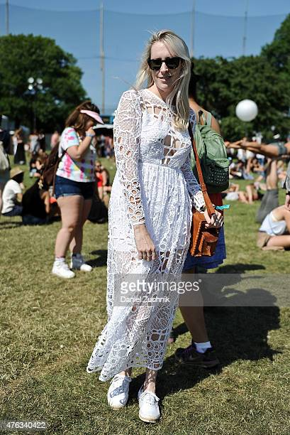 Sarah Owen is seen wearing an Alice McCall dress and Warby Parker sunglasses during the 2015 Governors Ball Music Festival at Randall's Island on...