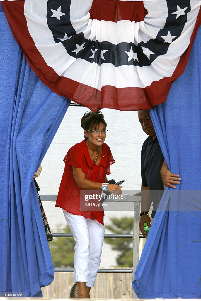 Sarah Palin, former Governor of Alaska and 2008 Republican vice presidential candidate, enters the stage to speak at the 'Patriots in the Park' Tea Party rally at the Wayne County Fairgrounds July 14, 2012 in Belleville, Michigan. The event was sponsored by Americans for Prosperity: Michigan and the Willow Run Tea Party Caucus.