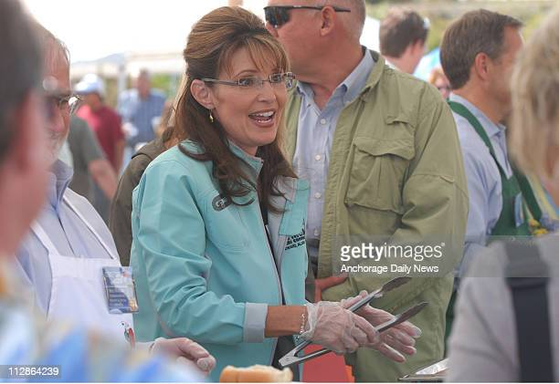 Sarah Palin serves hot dogs during the Governor's Picnic at Pioneer Park in Fairbanks Alaska on Sunday July 26 2009