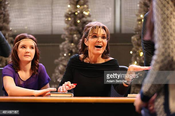 Sarah Palin signs copies of her new book Good Tidings and Great Joy Protecting the Heart of Christmas on November 21 2013 at Mall of America in...