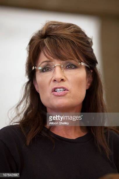 Sarah Palin speaks during a press conference with Franklin Graham in a supply warehouse on the grounds of the Samaritan's Purse compound on December...