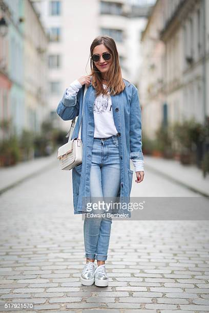 Sarah Partouche is wearing a Heavenking white top Asos blue jeans Superga Asos gray shoes and a Zara white bag during a street style session in the...