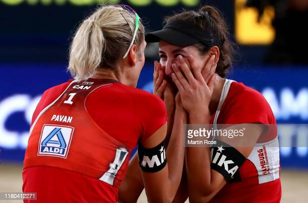 Sarah Pavan and Melissa Humana Paredes of Canada celebrate after winning the gold medal match against April Ross of United States and Alix Klineman...