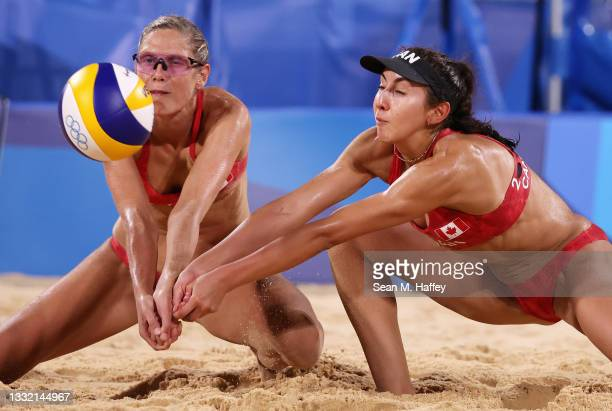 Sarah Pavan and Melissa Humana-Paredes of Team Canada compete against Team Australia during the Women's Quarterfinal beach volleyball on day eleven...