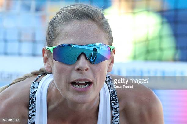 Sarah Pavan looks to her new teammate Melissa Humana-Paredes. The play in game between former Olympic teammates Heather Bansley and Sarah Pavan in...