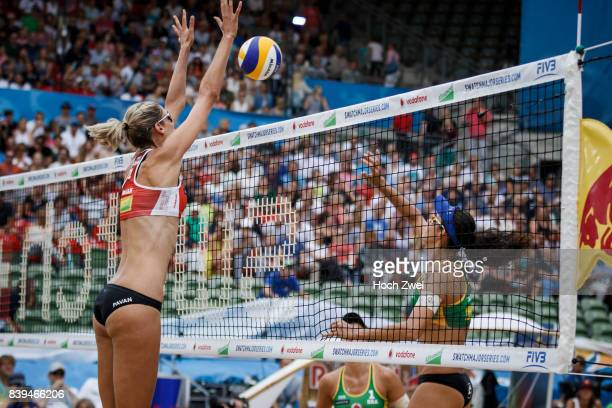 Sarah Pavan of Canada competes against Talita Da Rocha Antunes of Brazil during Day 4 of the Swatch Beach Volleyball FIVB World Tour Finals Hamburg...
