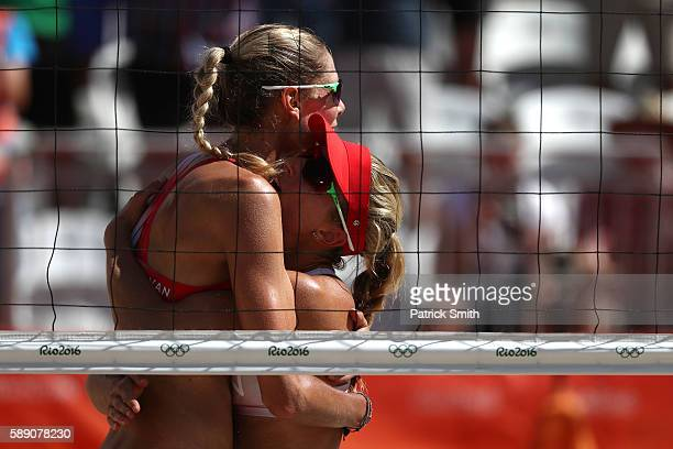 Sarah Pavan of Canada embraces teammate Heather Bansley after winning a Women's Round of 16 match between Canada and Canada on Day 8 of the Rio 2016...