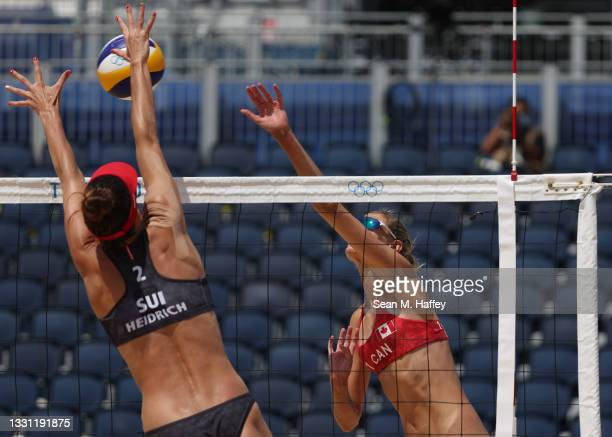 Sarah Pavan of Team Canada hits against Joana Heidrich of Team Switzerland during the Women's Preliminary - Pool A beach volleyball on day six of the...