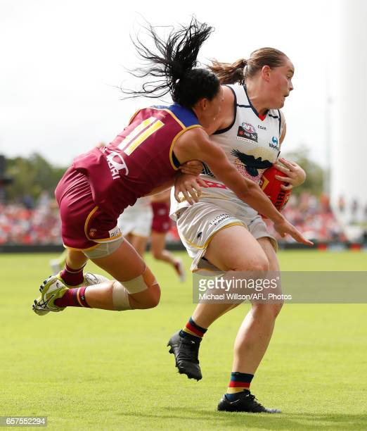 Sarah Perkins of the Crows and Leah Kaslar of the Lions in action during the 2017 AFLW Grand Final match between the Brisbane Lions and the Adelaide...