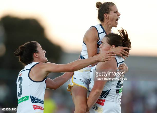 Sarah Perkins of the Crows celebrates a goal with Chelsea Randall and Angela Foley of the Crows during the 2017 AFLW Round 02 match between the...