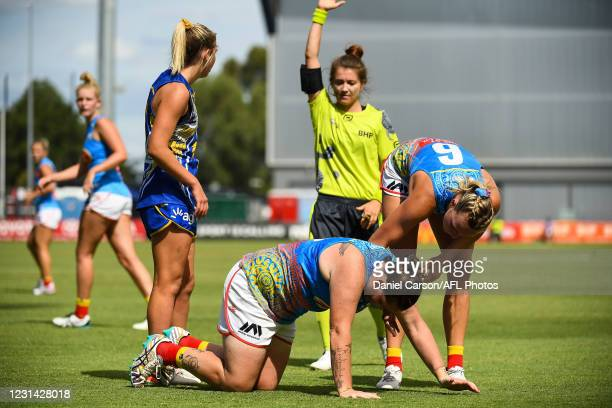 Sarah Perkins of the Suns lies face down on the ground after a tackle during the 2021 AFLW Round 05 match between the West Coast Eagles and the Gold...