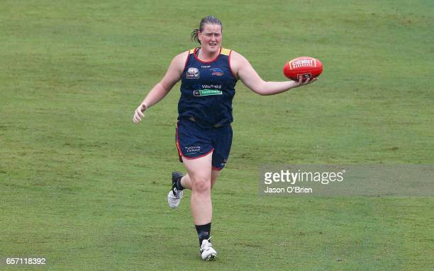 Sarah Perkins runs with the ball during an AFL Women's Adelaide Crows training session at Metricon Stadium on March 24 2017 in Gold Coast Australia