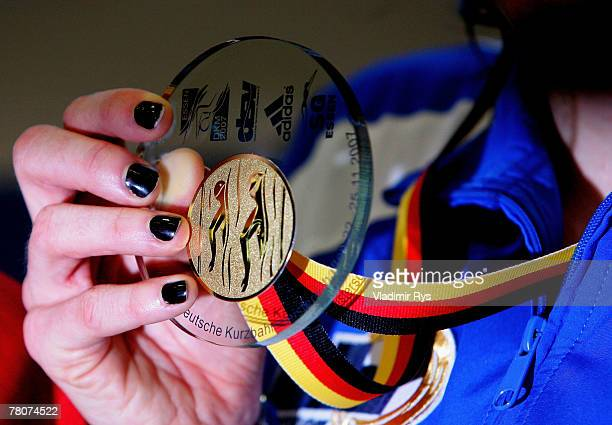 Sarah Poewe of SG Bayer presents her medal at the medal ceremony after winning the 100m breast final during the German Swimming Short Track...