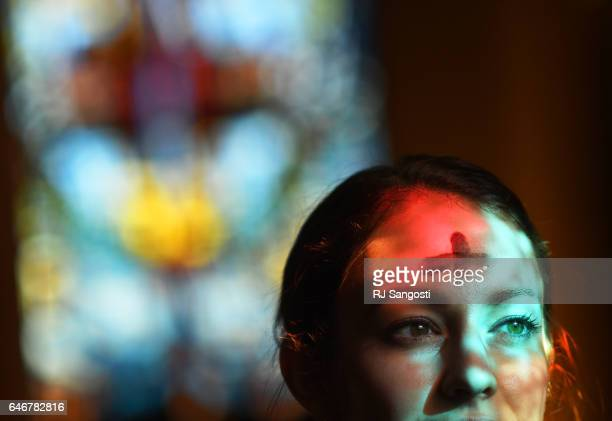 Sarah Porter attends Ash Wednesday Mass at Christ the King Catholic Church in Denver March 01 2017 Ash Wednesday opens Lent a season of fasting and...