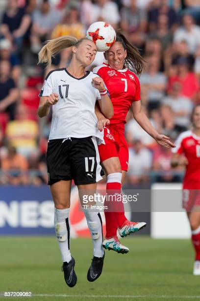 Sarah Puntigam of Austria and Martina Moser of Switzerland battle for the ball during the Group C match between Austria and Switzerland during the...