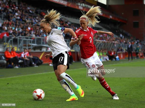 Sarah Puntigam of Austria is tackled by Line Roddik of Denmark during the UEFA Women's Euro 2017 Semi Final match between Denmark and Austria at Rat...