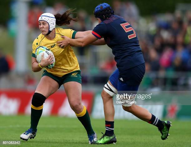 Sarah Riordan of Australia is tackled by Audrey Forlani of France during the Women's Rugby World Cup 2017 match between France and Australia on...