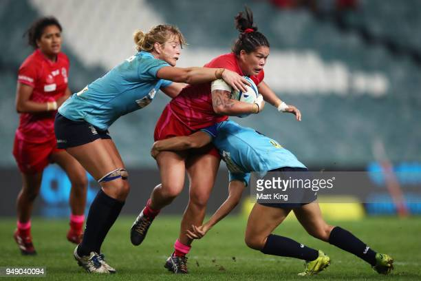 Sarah Riordan of Queensland is tackled during the Super W Grand Final match between the the New South Wales Women and the Queensland Women at Allianz...