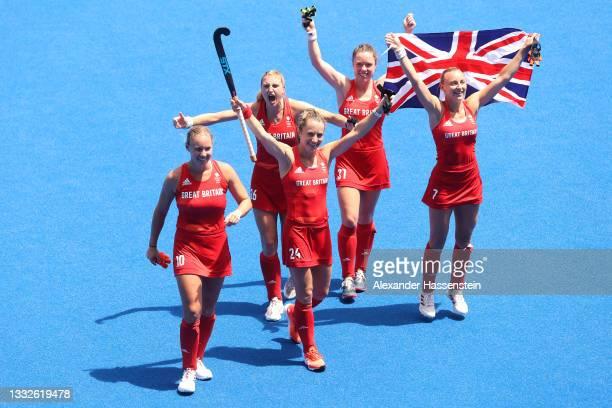 Sarah Robertson, Shona McCallin, Lily Owsley, Grace Balsdon and Hannah Martin of Team Great Britain celebrate winning the Women's Bronze medal match...