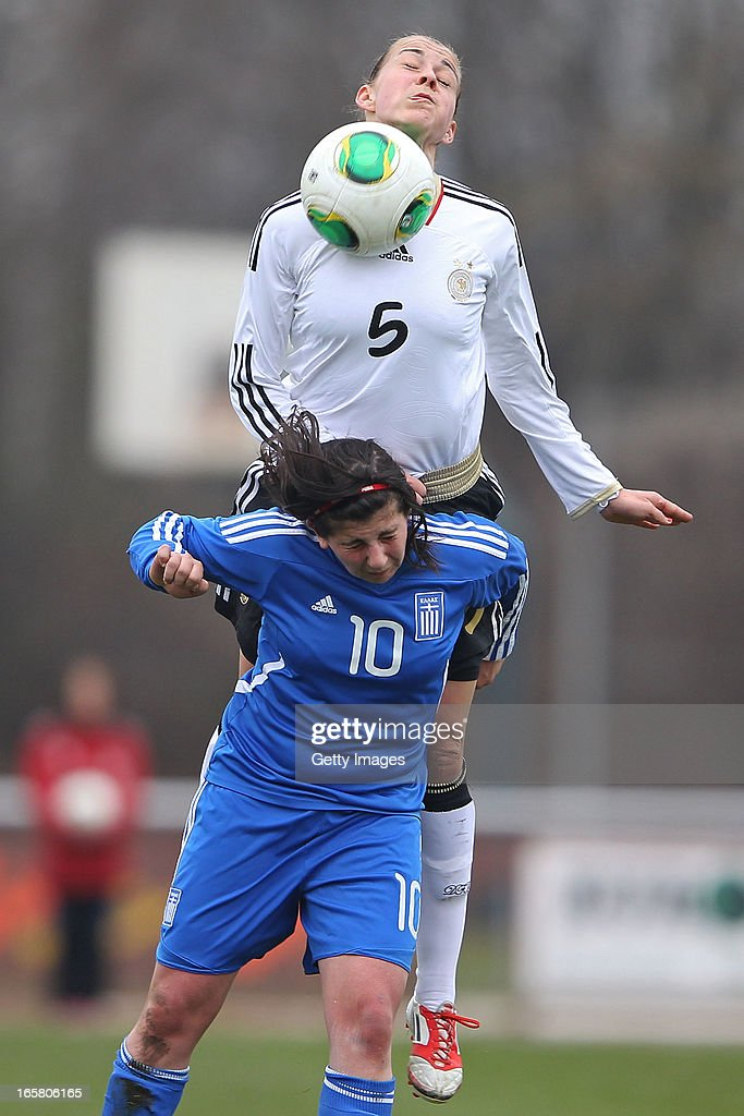 Sarah Romert (#5) of Germany jumps for a header with Christina Kokoviadou of Greece during the Women's UEFA U19 Euro Qualification match between U19 Germany and U19 Greece at Sportzentrum Sued on April 6, 2013 in Kirchheim, Germany.