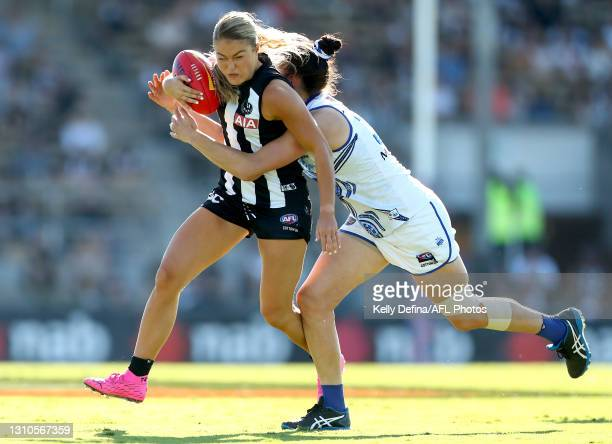 Sarah Rowe of the Magpies is tackled by Danielle Hardiman of the Kangaroos during the AFLW Finals Series match between the Collingwood Magpies and...
