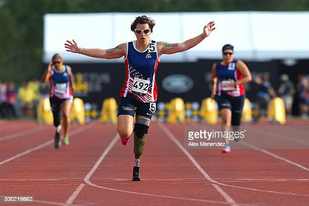Sarah Rudder crosses the finish line in first place during the Invictus Games Orlando 2016 Track Field Finals at the ESPN Wide World of Sports...