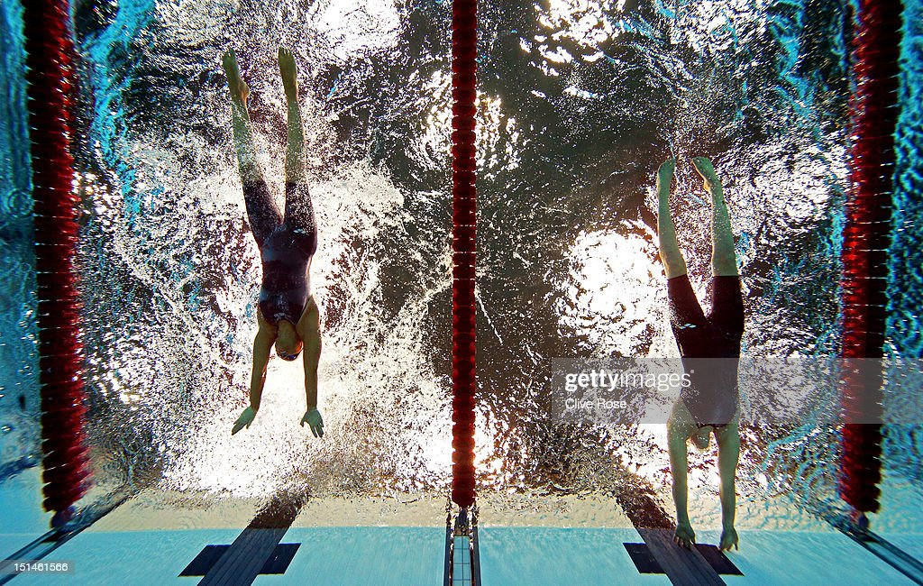 Sarah Rung (R) of Norway touches the wall ahead of Teresa Perales (L) of Spain to win gold in the Women's 50m Butterfly - S5 final on day 9 of the London 2012 Paralympic Games at Aquatics Centre on September 7, 2012 in London, England.