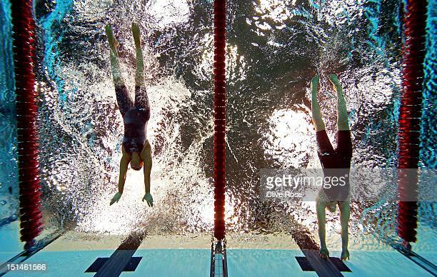 Sarah Rung of Norway touches the wall ahead of Teresa Perales of Spain to win gold in the Women's 50m Butterfly S5 final on day 9 of the London 2012...