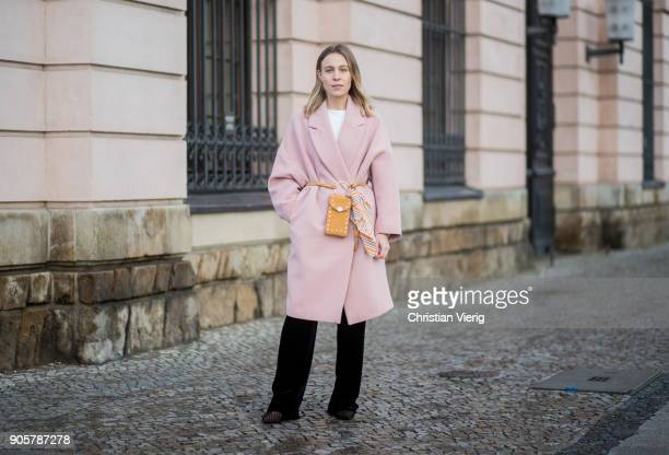 Sarah Schaefer wearing pink HM trend coat black pants Mango tshirt Edited Zara shoes bag HM yellow Zara scarf is seen outside Der Berliner Modesalon...
