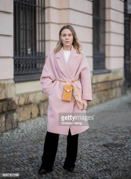 Sarah Schaefer wearing pink HM trend coat black pants Mango tshirt Edited Zara shoes bag HM yellow Zara scarf is seen outside Der Berliner Modesalon...