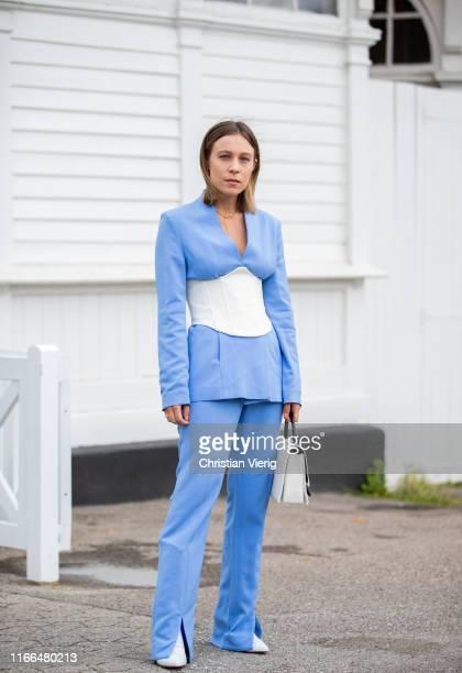 Sarah Schäfer is seen wearing blue pants, blazer, white corset outside Blanche during Copenhagen Fashion Week Spring/Summer 2020 on August 06, 2019...