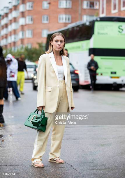 Sarah Schäfer is seen wearing yellow coat green Boyy bag outside Saks Potts during Copenhagen Fashion Week Spring/Summer 2020 on August 08 2019 in...