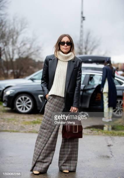 Sarah Schäfer seen wearing turtleneck knit, checkered wide leg pants, bordeaux Boyy bag, black leather jacket outside Rodebjer during Copenhagen...