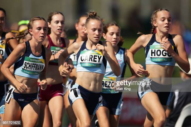 Sarah Schiffmann Lauren Carey and Nicola Hogg of NSW compete in the Women's 3000 Metre Run Under 16 during day one of the Australian Junior Athletics...