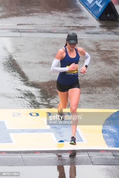 Sarah Sellers of the United States crosses the finish line in second place for the 2018 and 122nd Boston Marathon for Elite Women's race with a time...