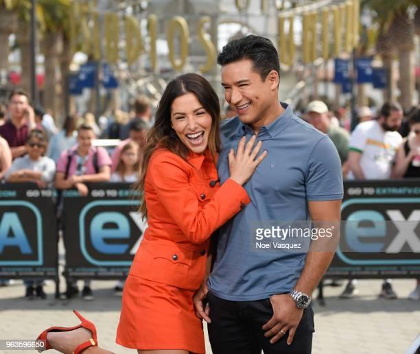Sarah Shahi and Mario Lopez visit Extra at Universal Studios Hollywood on May 29 2018 in Universal City California