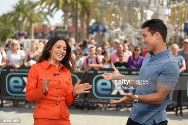 Sarah Shahi and Mario Lopez visit 'Extra' at Universal Studios Hollywood on May 29 2018 in Universal City California