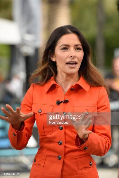 Sarah Shahi visits 'Extra' at Universal Studios Hollywood on May 29 2018 in Universal City California