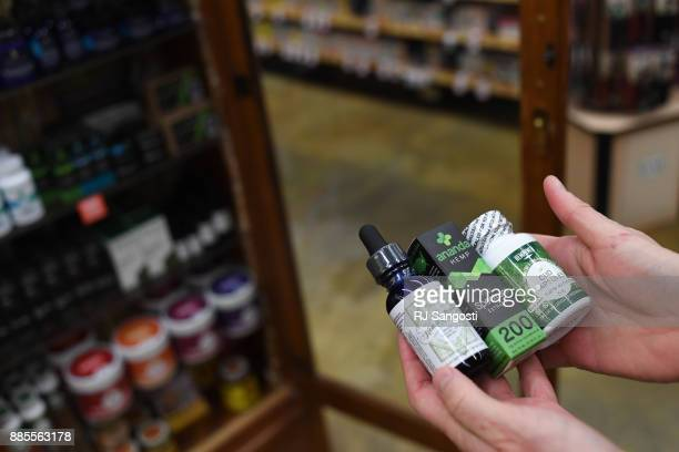 Sarah Shebanek wellness buyer for Alfalfa's works with the CBD oil supplements the store sells on December 4 2017 in Boulder Colorado