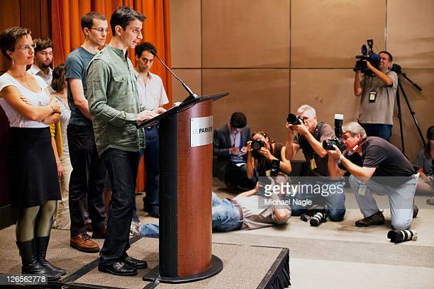 Sarah Shourd and Josh Fattal stand behind Shane Bauer as he speaks at press conference at the Parker Meridien New York after Bauer and Fattal's...