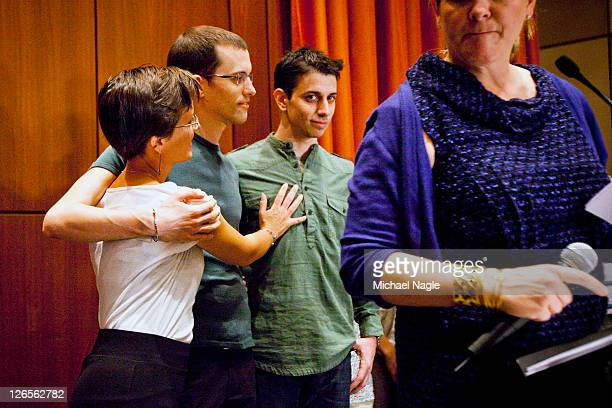 Sarah Shourd embraces Shane Bauer and Josh Fattal two American hikers released after spending more than two years imprisoned in Iran after a press...