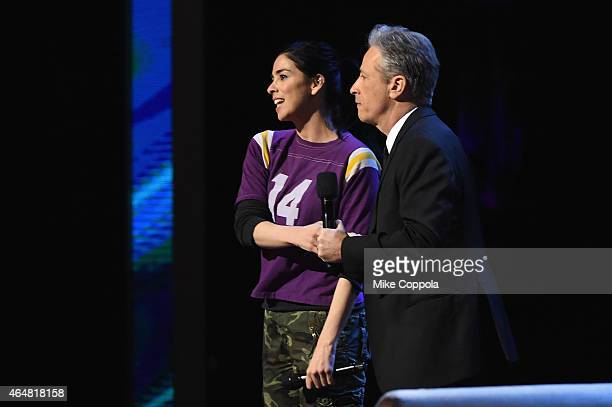 Sarah Silverman and Jon Stewart perform onstage at Comedy Central Night Of Too Many Stars at Beacon Theatre on February 28 2015 in New York City
