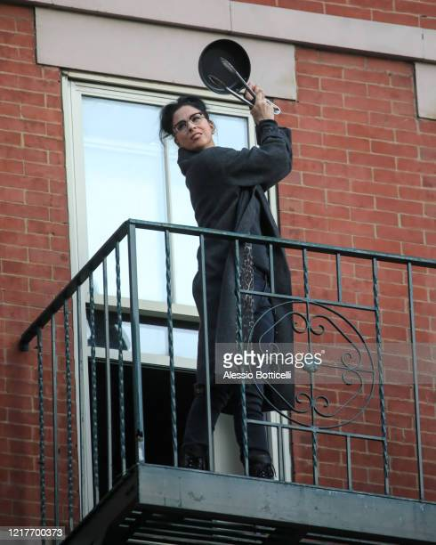 Sarah Silverman is seen on a fire escape cheering for emergency and medical workers on April 08, 2020 in New York City.