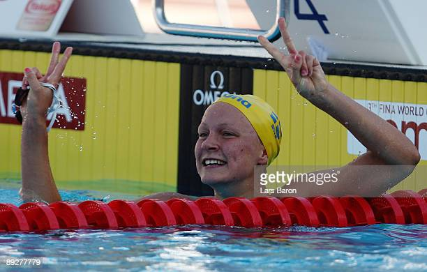 Sarah Sjostrom of Sweden celebrates after breaking the world record setting a new time of 5606 seconds in the Women's 100m Butterfly Final during the...
