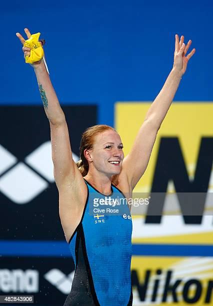 Sarah Sjostrom of Sweden celebrates after winning the gold medal and breaking a new world record of 55.64 in the Women's 100m Butterfly Final on day...