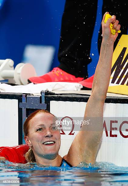 Sarah Sjostrom of Sweden celebrates after winning the gold medal and breaking a new world record of 5564 in the Women's 100m Butterfly Final on day...