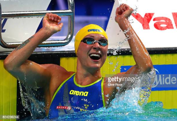 Sarah Sjostrom of Sweden celebrates after winning the gold medal during the Women's 50m Butterfly final on day sixteen of the Budapest 2017 FINA...
