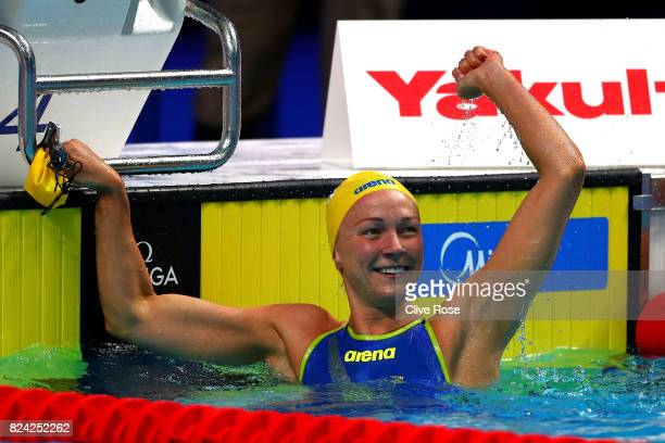 Sarah Sjostrom of Sweden celebrates as she sets a new world record time of 2667 during the Women's 50m Freestyle semi final on day sixteen of the...